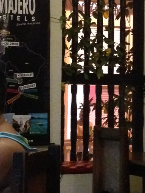 Looking through the shutters of the hostel' windows, can you see the man across the way watching us?  It's easy to be a voyer here, taking peeks through open doors at the wonders within plain doors.
